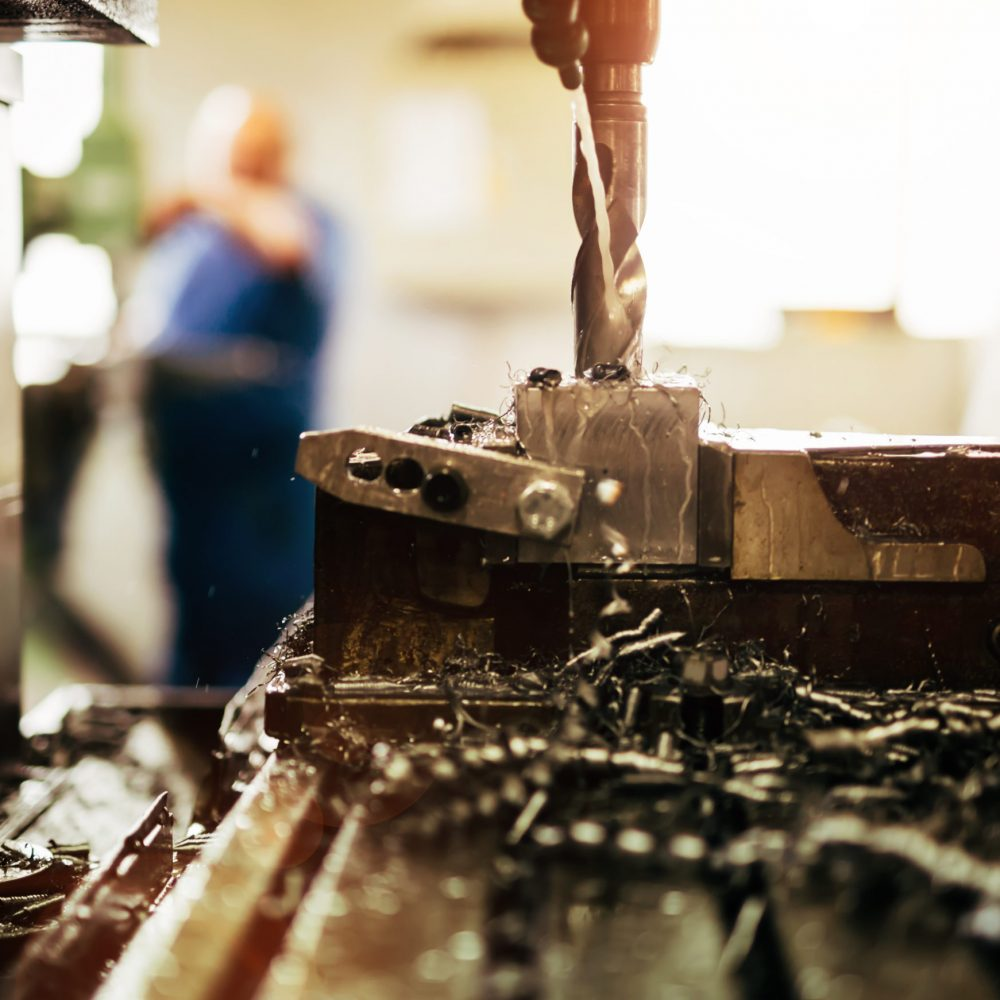 Automated drilling machines processing metalwork for assembly robots